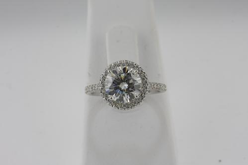 View Round Micro Pave Halo Engagement Ring
